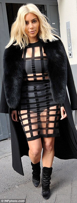 26714C6F00000578-2985326-Who wore it better Kim was dressed in a daring Balmain dress tha-a-13 1425836915419 9e16e