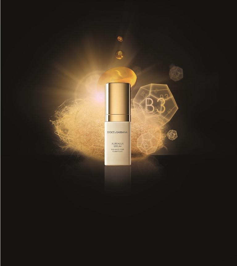 DolceGabbana Skincare Aurealux Serum creative pack shot with ingredients 9b9da