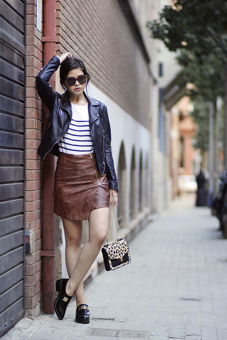 03 stradivarius leather jacket spring hm faux leather tan wrap skirt zara metallic loafers reiss elliot leopard bag striped knit karen walker number one sunglasses ootd1 84d9c