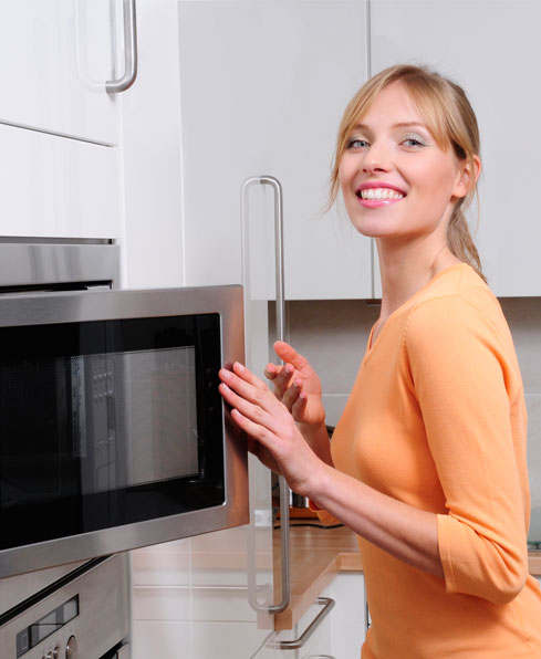 woman cleaning a microwave 209c4