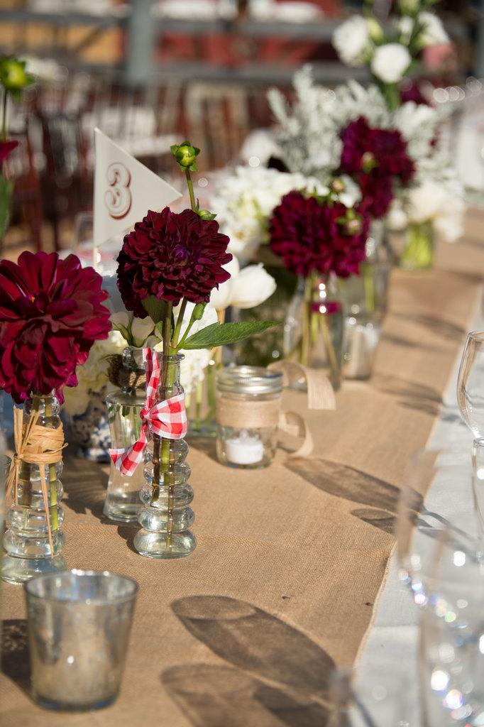 Place single stemmed flowers burlap table runner 82977