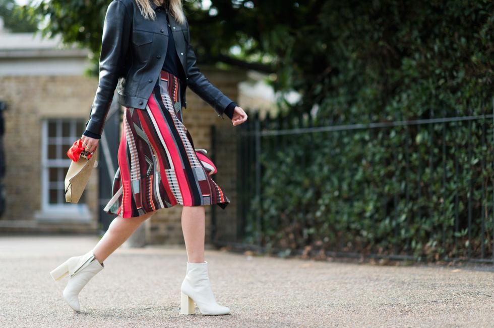 mod booties white boots patchwork prints fall prints fall skirts midi knee skirt leather jacket via lfw street styleelle.com