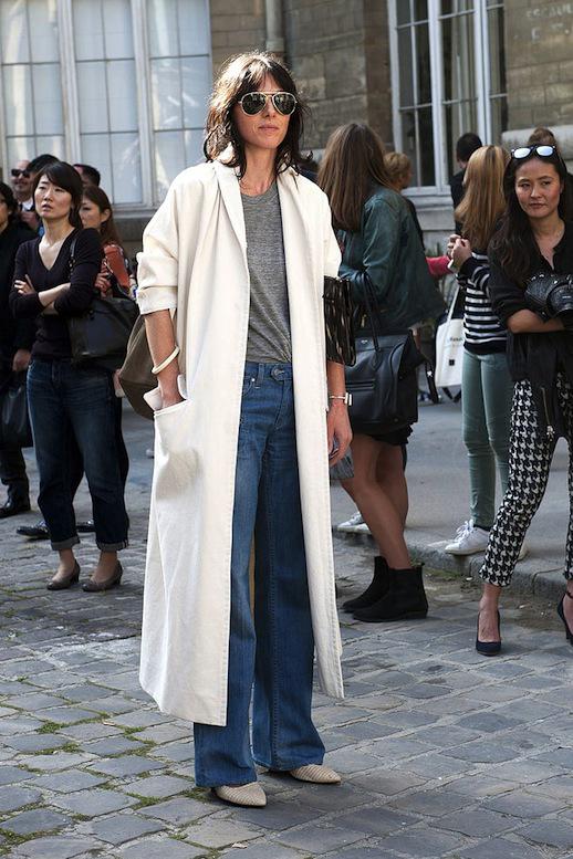Le Fashion Blog Street Style Pfw Aviator Sunglasses White Maxi Jacket Grey Tee Wide Leg Jeans Pointy Toe Textured Boots Via Popsugar
