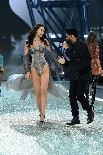 holding bella hadid the weeknd vs fashion show