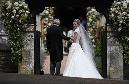 Pippa Middleton R is escorted by her