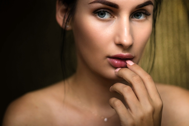 photo of woman holding lips 1204505