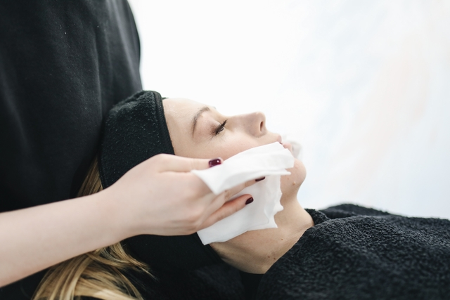 photo of person using a tissue to dry a woman s face 3738344