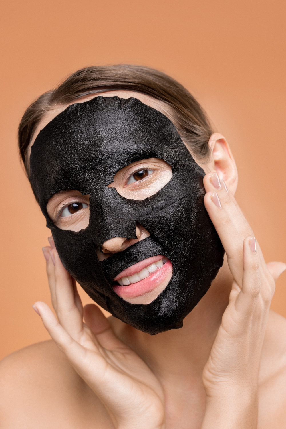 person covering face with black mask 3762559