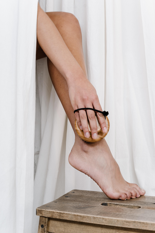 person wearing scrubbing her leg 3737823