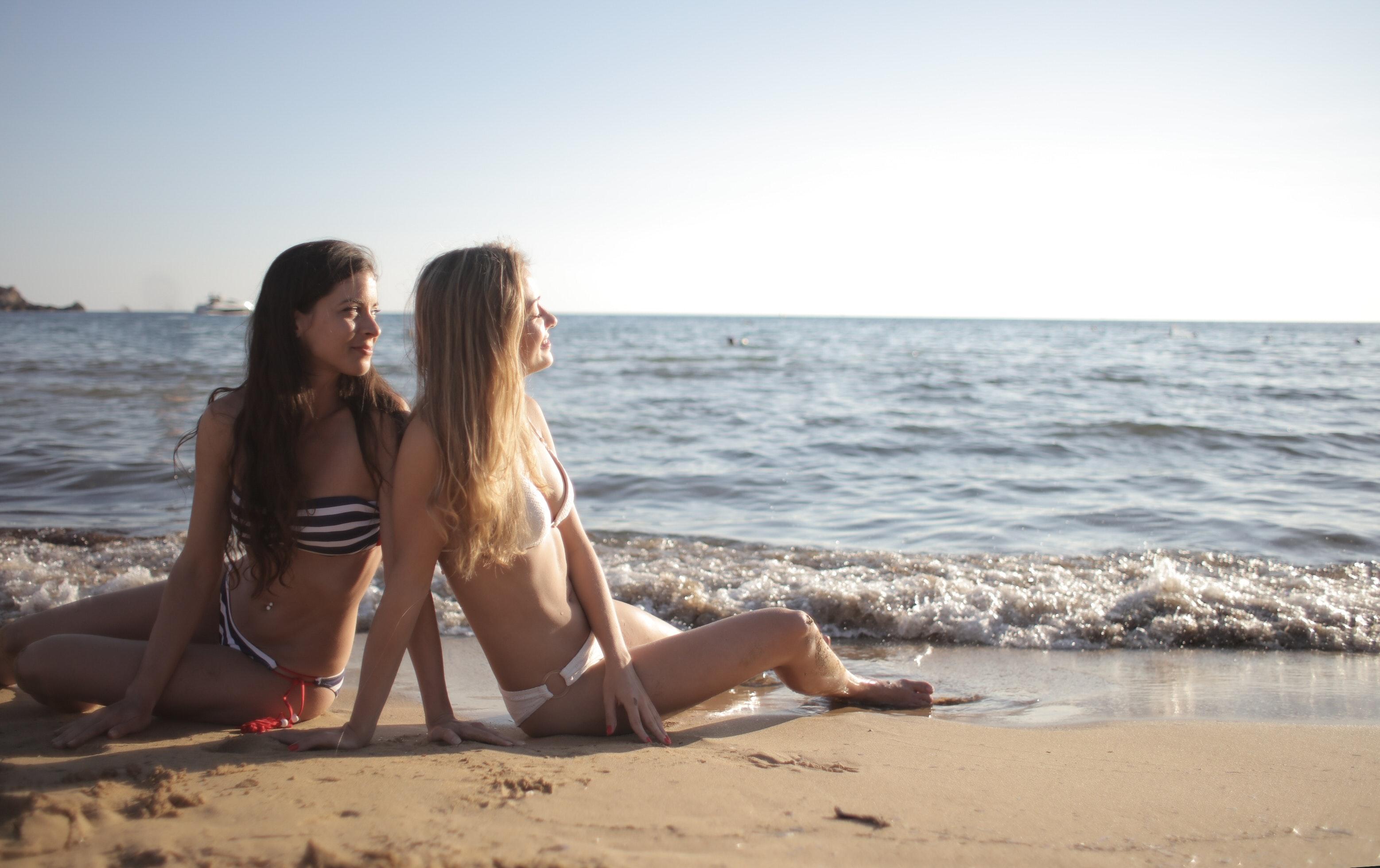 happy women relaxing on sandy beach 3847863