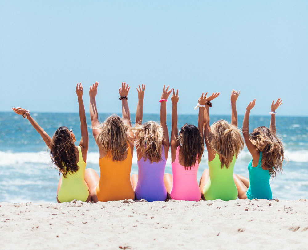 back view photo of six girls wearing swimsuit sitting on 2647973